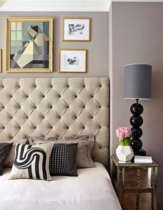 Bedroom with taupe tufted upholstered headboard