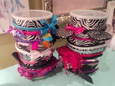 Headband holder I made for LG. Empty oatmeal container and some zebra print duct tape. Easy DIY headband organizer!  You can store clips, elastics, or bows inside the canisters too.