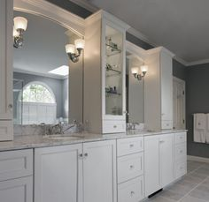 Totally doing this in the master...found 4 white real wood construction cabinets just like the ones on the vanity, at Goodwill today!!!