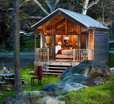 a tiny one bedroom log cabin escape spot along the river! How cute is this?