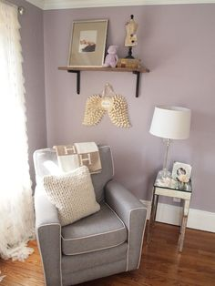 Ours is a similar color palette: dusty purple/grey walls, white crib, white bookshelf, grey and white dresser, light brown carpeting