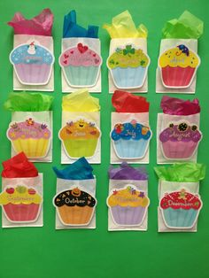 """She stapled these white paper bags to the wall and filled them with tissue paper.  Then wrote the students' birthdays on the cupcakes and put a birthday pencil in the bag for them.  Easy way to see the birthdays coming up and ensure that you have their gift ready. She used CTP's Cupcakes 6"""" Designer Cut-Outs for inspiration!"""