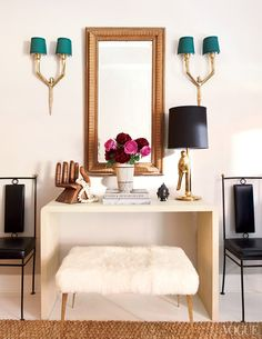 Karlie Kloss' home in NYC: sheepskin bench, gold mirror, & brass and emerald sconces