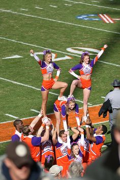 College #Cheer, Clemson cheerleaders, collegiate, stunt, pyramid, game day, cheerleading