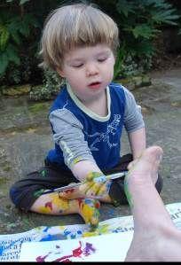 Feet painting fish - love the boy painting his mama's feet!
