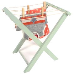 This wooden clothes dry rack is perfect for doll clothes. Folds flat and comes with 10-12 wooden pegs. Dimension: 10.5 inches tall.