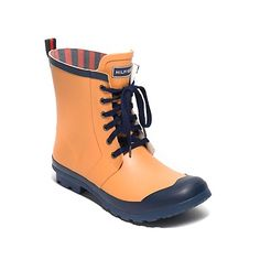 Tommy Hilfiger women's boot. Give fall puddles or winter slush the boot. These slickers are just the ticket with a hearty lugged sole and decorative lace up vamp. Equally apropos in the fields upcountry or dodging splashes downtown. And yes, they're completely leak-proof. <br>• Boot silhouette in rubber. <br>• Padded insole, rubber outsole, signature on tongue. <br>• 1'' heel. <br>• Imported. <br>