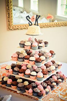 A cute cupcake tower topped with a monogram mini cupcakes, wedding cupcakes, cupcak tower, wedding cakes, shower, cupcake cakes, small cakes, cupcake towers, dessert