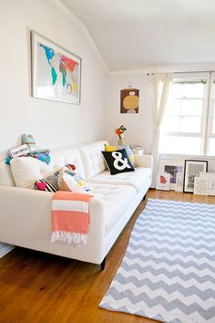 design pattern, living rooms, couch, rug, living room art, map, design blogs, white wall, chevron stripes