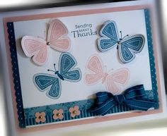 Butterflies in shades of Island Indigo and Blushing Bride.  The colors are layered on white, along with pink petals and a blue bow on this handmade thank you card.