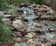 Landscape ideas on pinterest fire pits flagstone and for Design of pond embankment