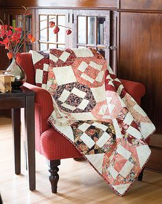 Like its name, this quilt is pretty. Diane Tomlinson used a great collection of lovely Asian-style prints and a plumeria blossom quilting design. Quilt kit and digital pattern available! Look for Kawaii in Easy Quilts Fall '14.