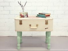 Give a vintage suitcase new life as a table by simply drilling holes into the bottom surface and attaching legs. (Bonus: The suitcase opens up to reveal a hidden storage space!)