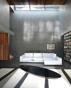 Dramatic double height living space with skylight, by Henri Cleinge.