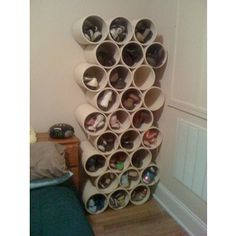 cut pvc pipes used as shoe storage, would be great in the back of the closet & use for scarves, hats etc...