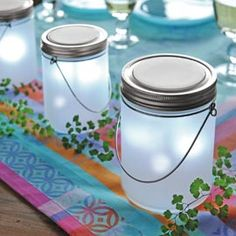 Frosted glass mason jars with tea lights. They look like fairy jars