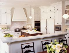 Mix of white cabinets with stained island