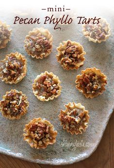 Pecan phyllo tarts 68 cal.  Ingredients:1 tbsp butter, melted   1 egg 4 tsp brown sugar 2 tbsp honey 1/4 tsp vanilla 1/2 cup pecans chop  15 Mini Phyllo Shells (Athens)   Directions:  Preheat oven to 350°F.  In a mixing bowl, combine all ingr. except pecans. Mix well. Stir in pecans. Arrange shells on a baking sheet. Fill mini shells with one teasp. of pecan mixture. Bake for 10-15 minutes.
