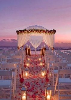 This is beautiful for a night wedding. You are always taking a risk on the beach withreal  candles because the beach is often windy. An alternative is to use battery powered flickering faux candles.