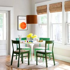white table; colorful accessories & chairs