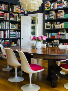 Love the mix of the chairs with the table- and all those books!