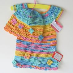 -Hand crocheted summer baby dress and matching hat.