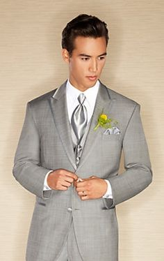 Grooms tux with a mint green tie. Groomsmen will have same tux with grey tie