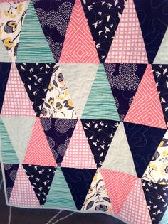 Pink, Navy, Teal Triangle Custom Quilt. Measures aprox 44x50. This quilt can be made with any fabrics and in any size. $98.00