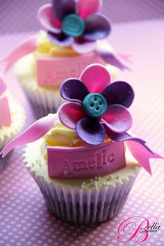 Button flower cupcakes.  Note the embossing on the petals and the stitching on the ribbon.  So fun, so fresh.