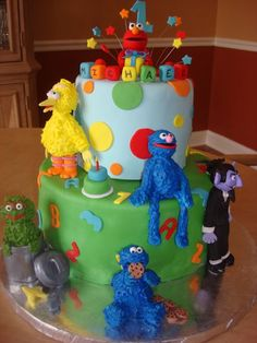 Sesame Street cake - This cake was for my friends nephews 1st birthday. He love Sesame Street, especially Elmo. All the character are made out of fondant and the covered with royal icing to give them some texture. It was fun to do.