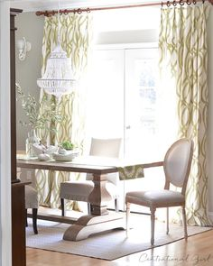 green & white dining room, mixed wood tones