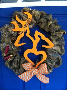 Camo buck and doe browning wreath. $45. Shot gun shells and orange chevron bow. www.facebook.com/michelleswreaths