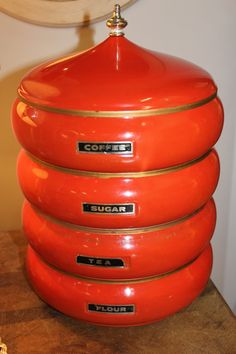 "Vintage orange stacking canister.  My mom had these back in the day but they were ""avocado green"".  Really is a cool set."
