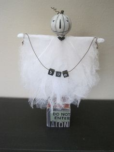 Primitive Folk Art Lumina White Pumpkin Head Ghost Doll  BOO on Wooden Block  Halloween. via Etsy.