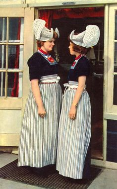 Europe | Portraiy of two women wearing traditional clothes, Volendam, North Holland, The Netherlands