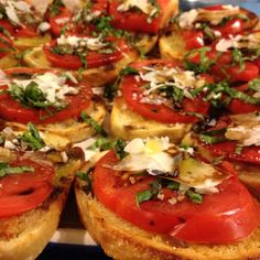Easy Fresh Bruschetta. Slice small loaf of monterey sour dough bread. Brush both sides with olive oil and grill broil both sides until golden brown. Top with sliced fresh heirloom tomatoes, chopped fresh basil and parmigiano reggiano cheese. Lightly drizzle balsamic vinegar and olive oil all over. Enjoy!!