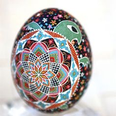 For inspiration: Pysanky Easter Egg with Turtle Image. Made by covering with wax and dyeing in multiple layers, but I'd like to paint designs that are as intricatey detailed and beautiful! from Delish.com
