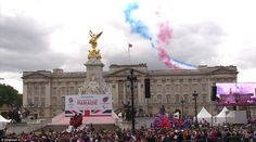Patriotic sky: Paralympics flypast over Buckingham Palace as the crowds watch