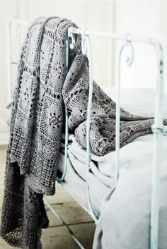 Love the blanket and iron bed frame.