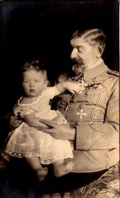 Two kings. Prince Mihai (future King of Romania) and his grandfather, King Ferdinand of Romania. Circa 1921-1922.