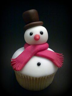 A deeply adorable little snowman cupcake that's been elegantly decorated with fondant. #cupcake #snowman #cake #food #decorated #dessert #baking #cute #Christmas #winter