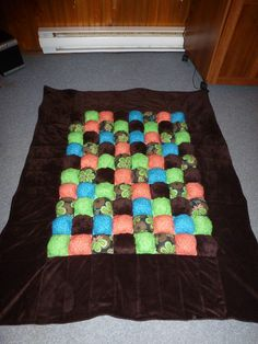 "Tummy time quilt for ""S"".  A biscuit quilt....short description would be a bunch of little pillows sewn together."