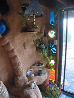 Various stained glass windows in a Cob house...