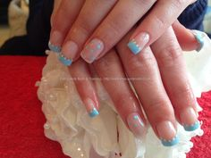 Gel overlays with babe blue tips ,white polka dots ,baby blue polka dots on ring fingers