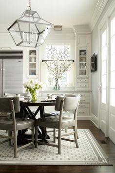 Grey kitchen, white cabinets, interesting lantern