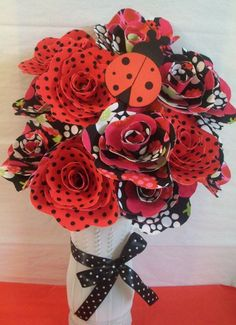 1 dozen handmade ladybug fabric flowers ,baby shower bouquet ,baby gift (custom orders welcome). $35.99, via Etsy.