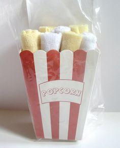 Dollar store popcorn container & baby washcloths!  Box of Popcorn!