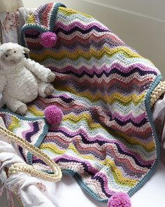 Chevron Buggy Blanket, FREE pattern by Nicki Trench, stunning, adore this and the pom poms! thanks so for share xox