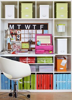 Color is key but organization is the theme in this office where everything is at the your fingertips. Color-coded binders and storage boxes keep everyday files and supplies organized. Small office supplies such as paper clips, pushpins, and pencils are kept in a jewelry box for easy access. The built-in bookcase includes a cozy writing desk backed with a weekly calendar/bulletin board.