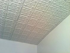 A glue-up ceiling installation using Fleur-de-lis White Ceiling Tiles, and Decorative Strips.